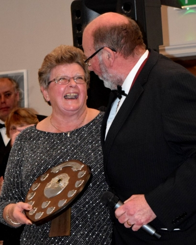 Region Chairman Mr Peter Wood Presents The Region's Frank Pratt Trophy to Elaine Simmonds. The Trophy is for Services to the Region and Da.